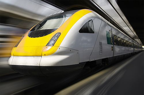 Picture of a yellow high speed train